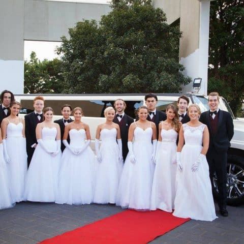 Debutante couples arriving at their presentation ball